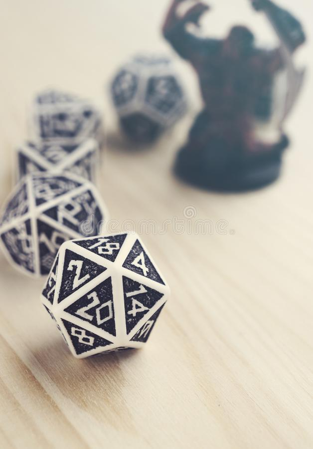 Balck and white dices for board, tabletop or rpg games. Shallow depth of field. Warm light. Hobby stock photos