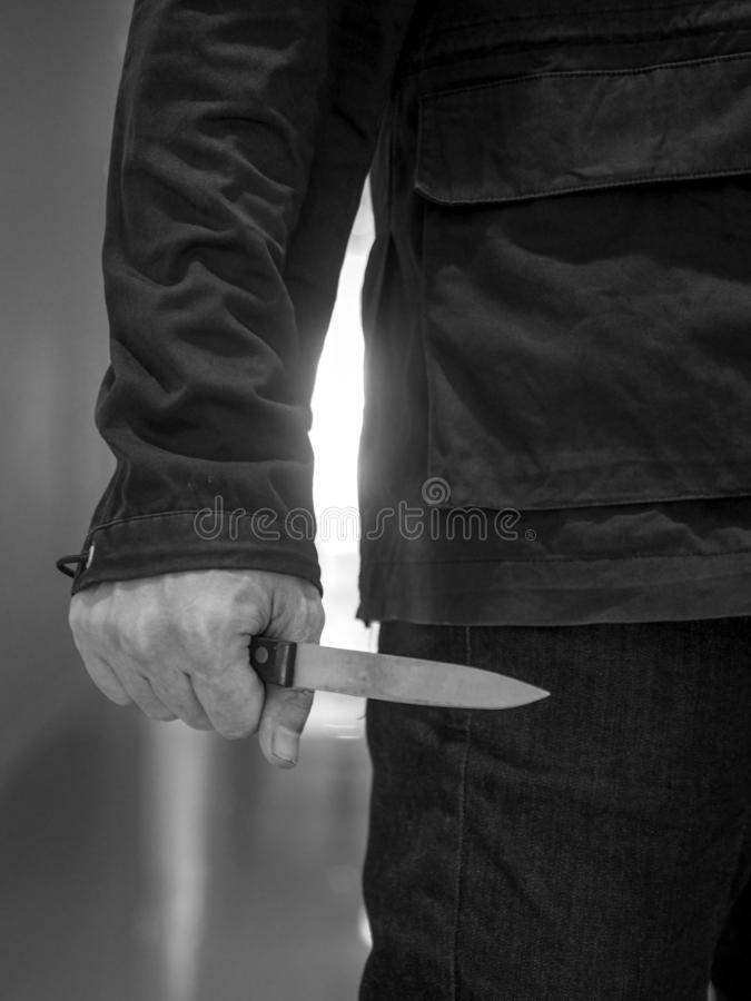Balck and white Killer man is attacking with knife royalty free stock photos