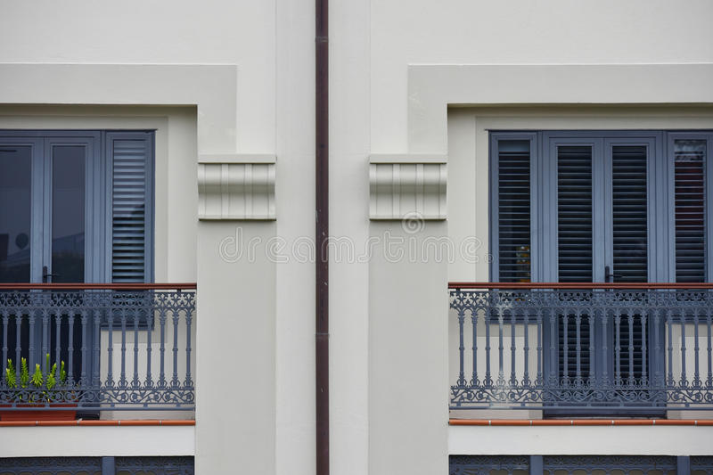 Balconies on apartments. Balconies of apartments with doors and window blinds reminding mediterranean vintage style royalty free stock photography