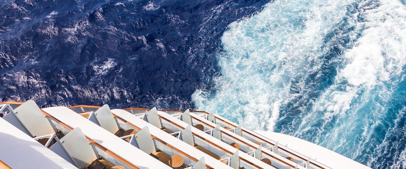 Balconies on a Cruise ship, decks with wake or trail. Balconies on a backof Cruise ship, decks with wake or trail on ocean surface stock photo