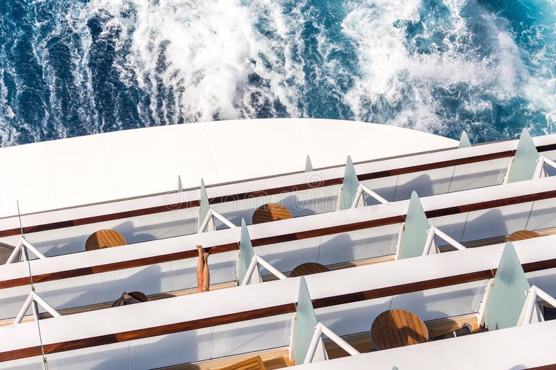 Balconies on a Cruise ship, decks with wake or trail. Balconies on a backof Cruise ship, decks with wake or trail on ocean surface royalty free stock photo