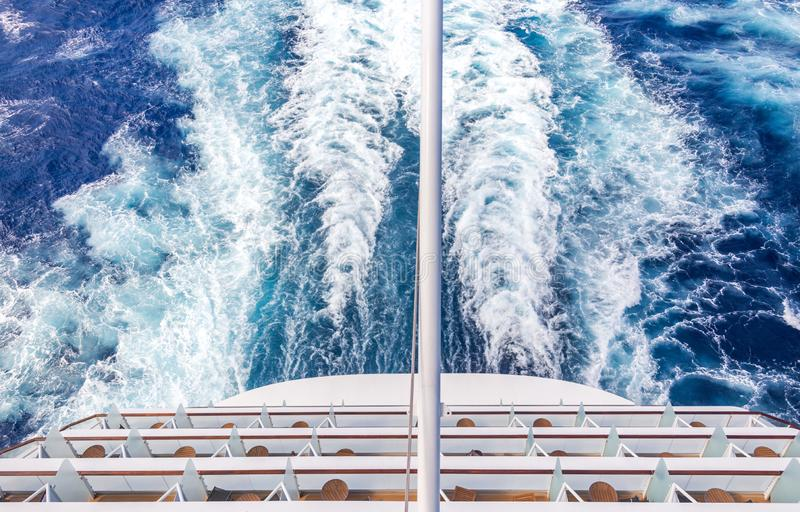 Balconies on a Cruise ship, decks with wake or trail. Balconies on a backof Cruise ship, decks with wake or trail on ocean surface stock image