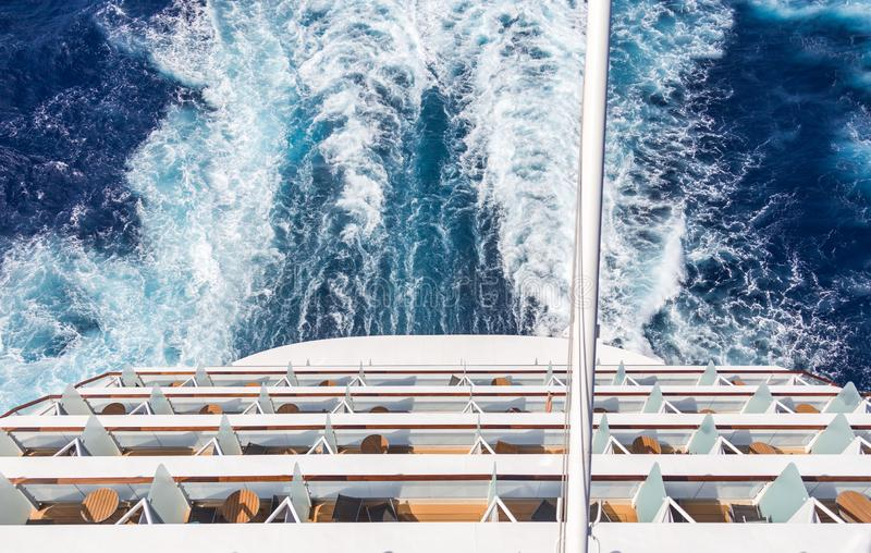 Balconies on a Cruise ship, decks with wake or trail. Balconies on a backof Cruise ship, decks with wake or trail on ocean surface stock images