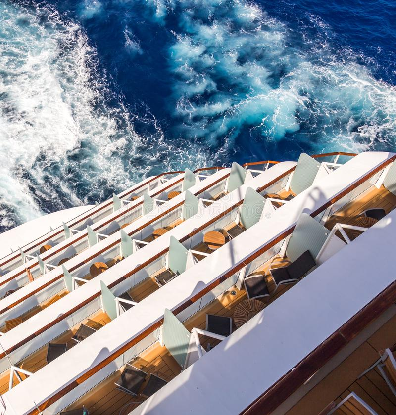 Balconies on a Cruise ship, decks with wake or trail. Balconies on a backof Cruise ship, decks with wake or trail on ocean surface royalty free stock photography