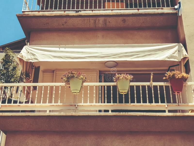 Balconies with flowerpots in Rishon Le Zion, Israel. Balconies with flowerpots in Rishon Le Zion, Israel royalty free stock image