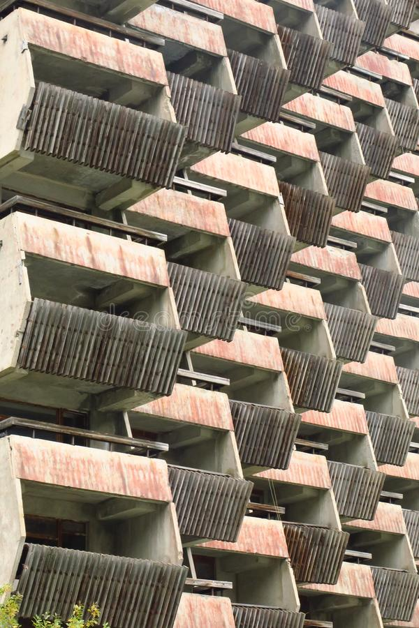 Balconies. Geometry. Wooden balconies of unfinished building royalty free stock photos