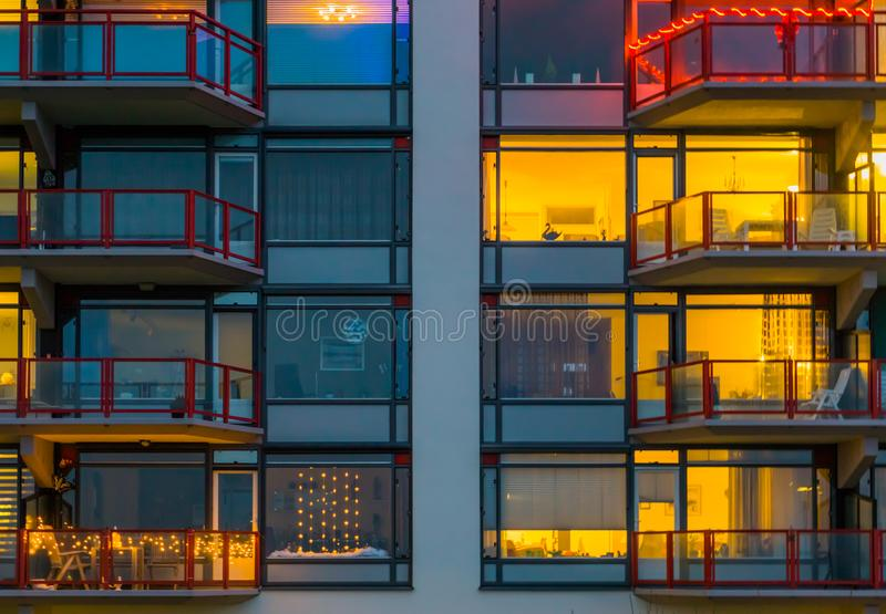 Balconies with lighted windows, Apartment complex at night, typical dutch architecture. Some balconies with lighted windows, Apartment complex at night, typical royalty free stock photography