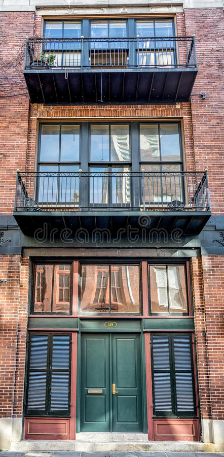 Balconies & Reflections in New Orleans LA. Balconies and window reflection in the French Quarter New Orleans LA royalty free stock images