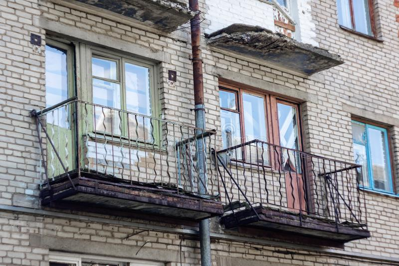 Balconies and windows on an old abandoned building stock photos