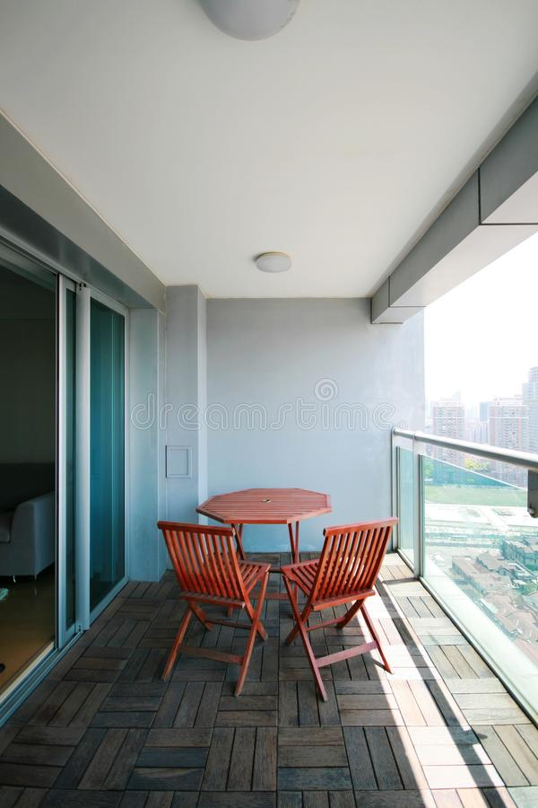 Balcony of an apartment. With chairs and table in Shanghai stock image
