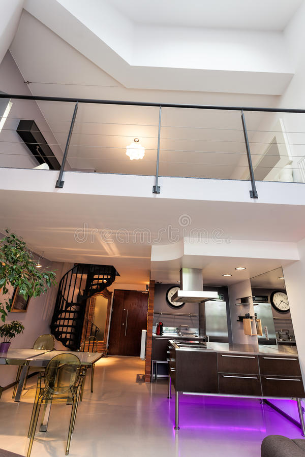Balcony in an apartment. Vertical photo of a loft apartment, modern interior stock photos