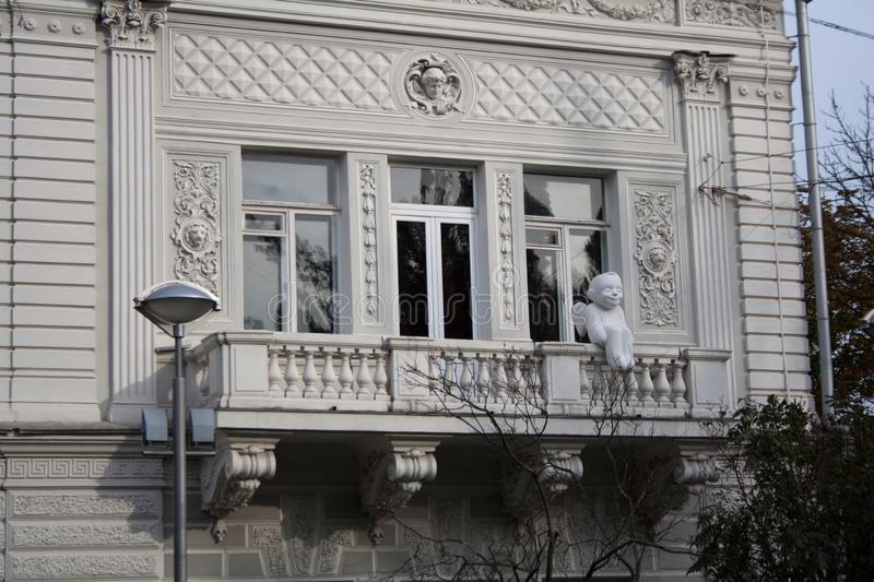 Balcony with baby angel sculpture stock photography