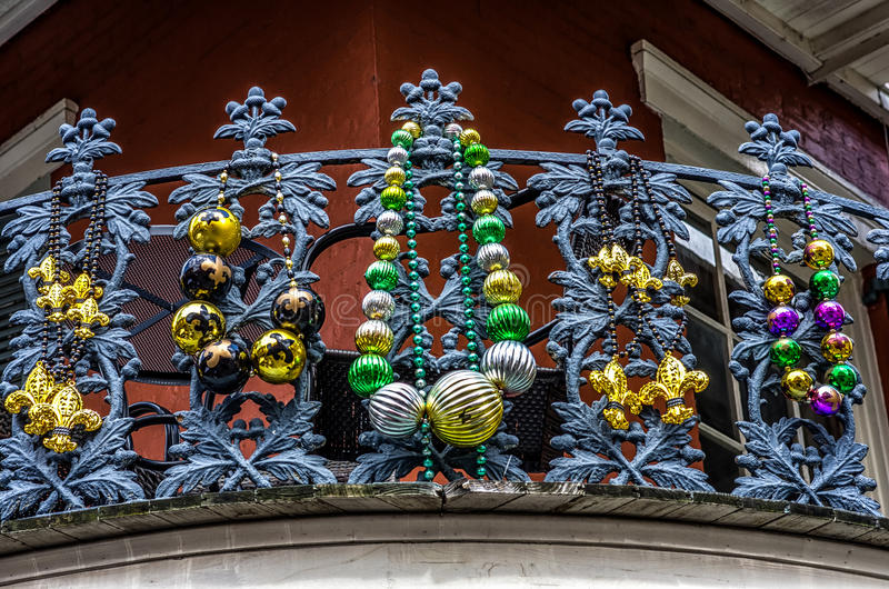 Balcony with Beads. 4-15-2012 New Orleans - Balcony with Mardi Gras Beads on railing bannister in the French Quarter royalty free stock image