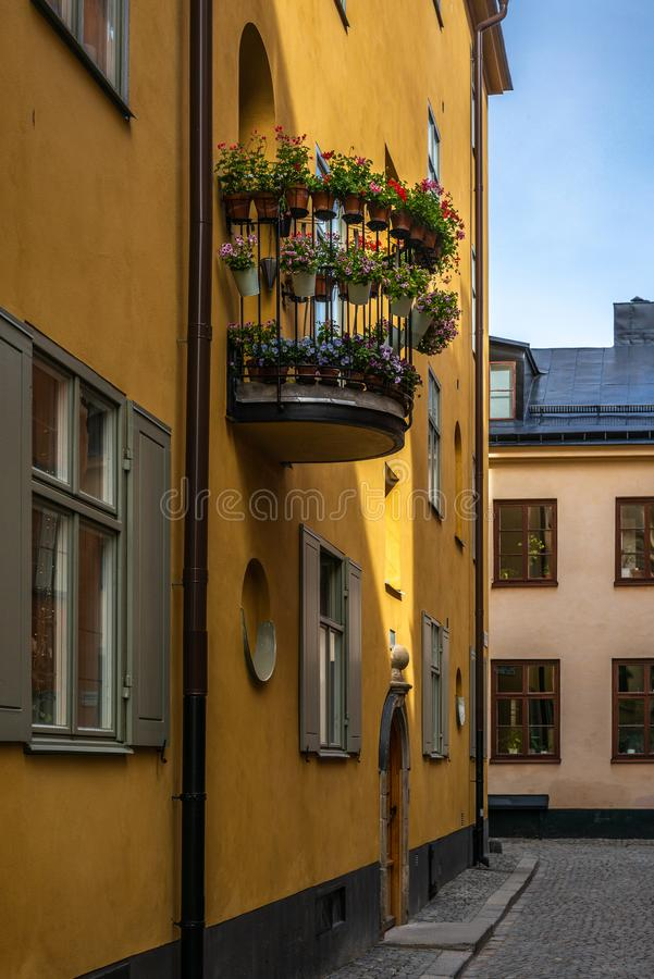 A balcony with colorful flower pots in the narrow cobbled streets of Stockholm in Spring. 1 stock images