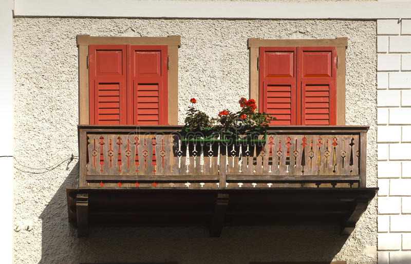Balcony with flowers, Cortina dAmpezzo, Italy stock photos