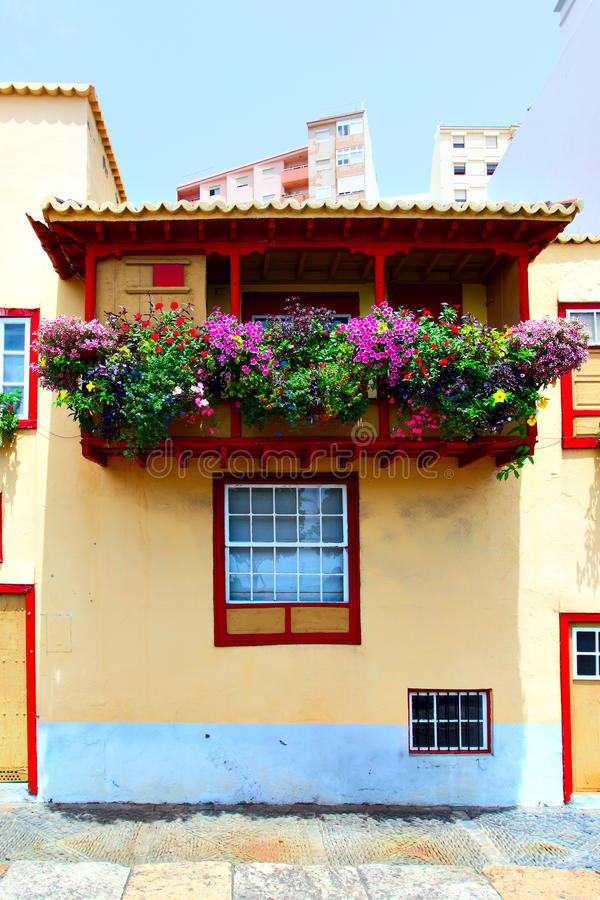 Balcony with flowers stock photography