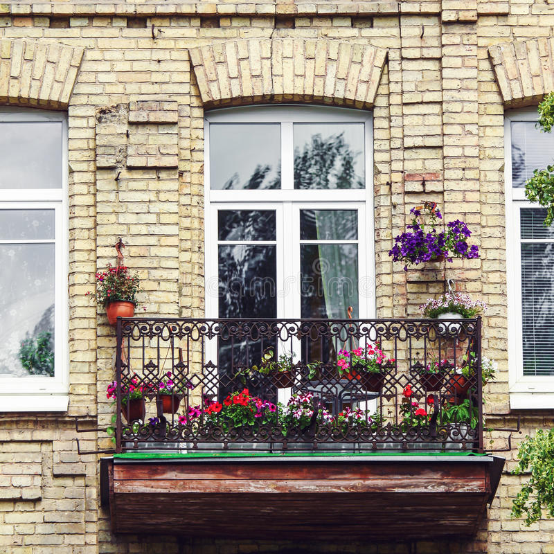 Balcony with flowers at summertime. Classic style balcony with flowers at summertime stock image