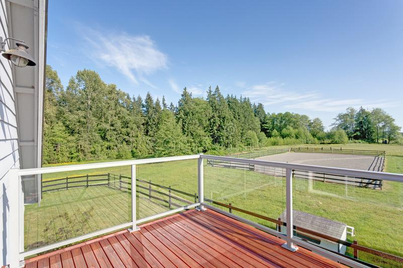 Balcony interior with picturesque view of the backyard. royalty free stock images