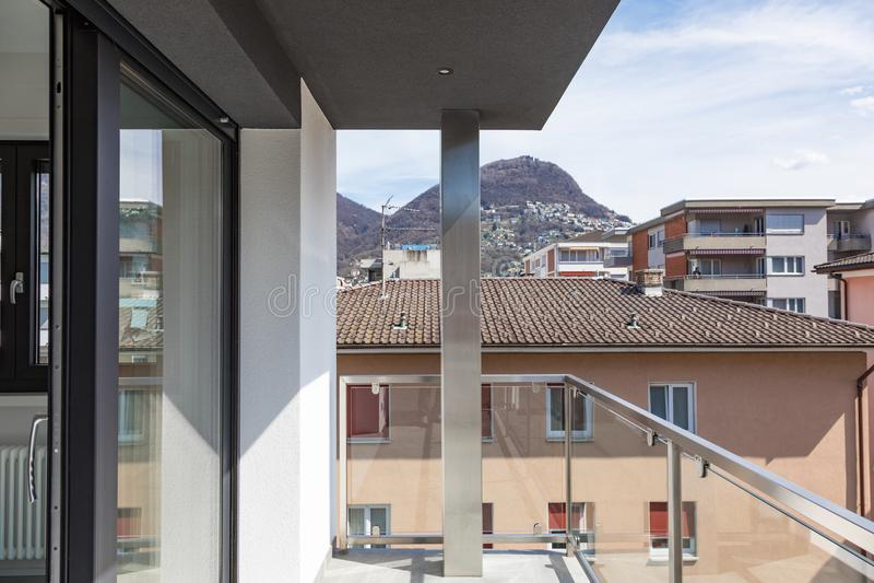 Balcony of modern building overlooking city stock photos