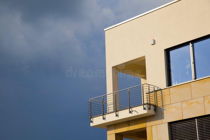 Balcony of modern flat with dark clouds. In rain stock photo