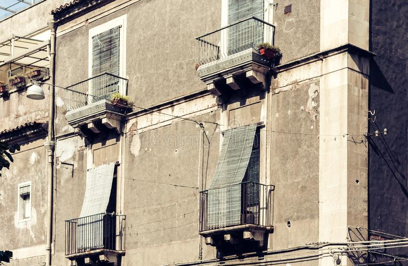 Balcony of old baroque building in Catania, traditional architecture of Sicily, Italy.  stock photos