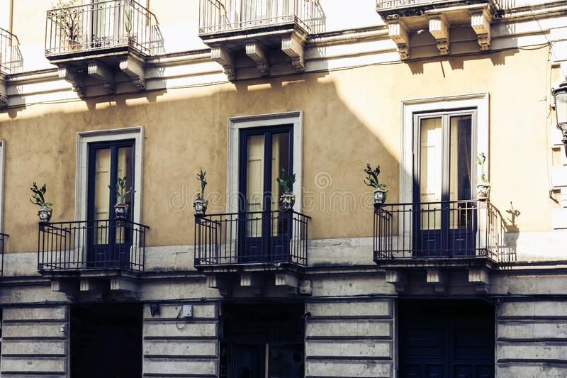 Balcony of old baroque building in Catania, traditional architecture of Sicily, Italy.  royalty free stock photo