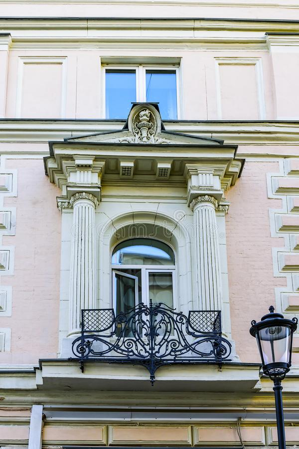Balcony in an old building with forged metal fence. Petrovsky pereulok 1/30с1. Moscow. Russia. Balcony in an old building with forged metal fence. Petrovsky royalty free stock image