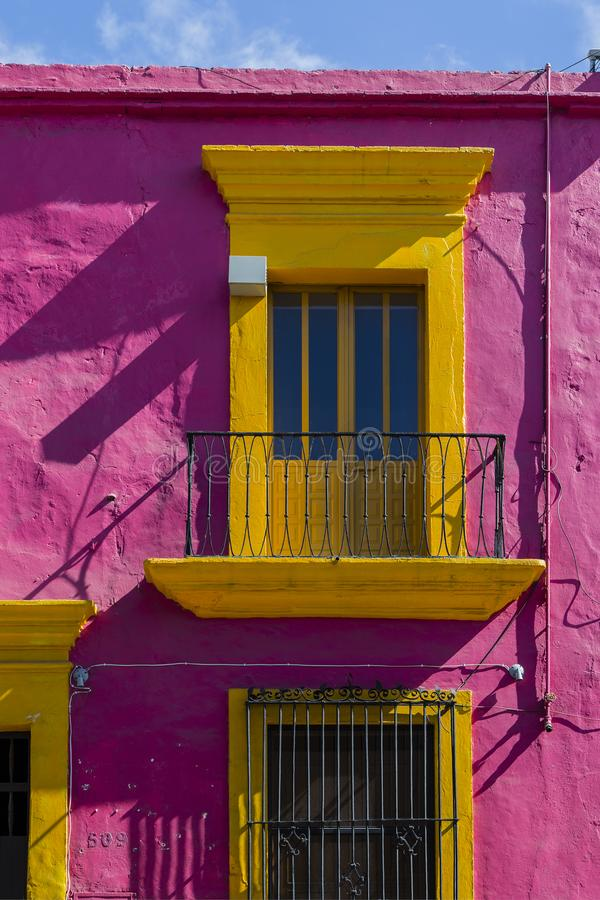 Balcony at old historic building in Oaxaca city with wonderful bright colors. By using a different color choice, this building in Oaxaca City is extra attractive stock image