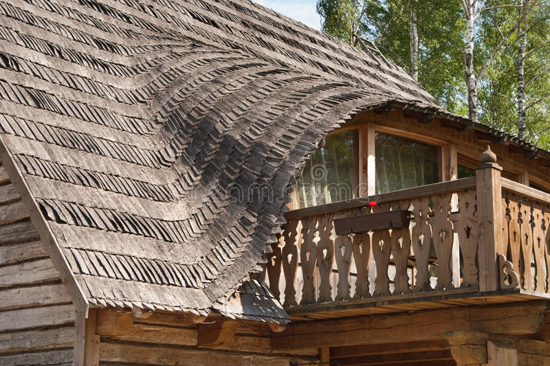 Balcony in rural wooden house. With traditional wooden roof royalty free stock photo