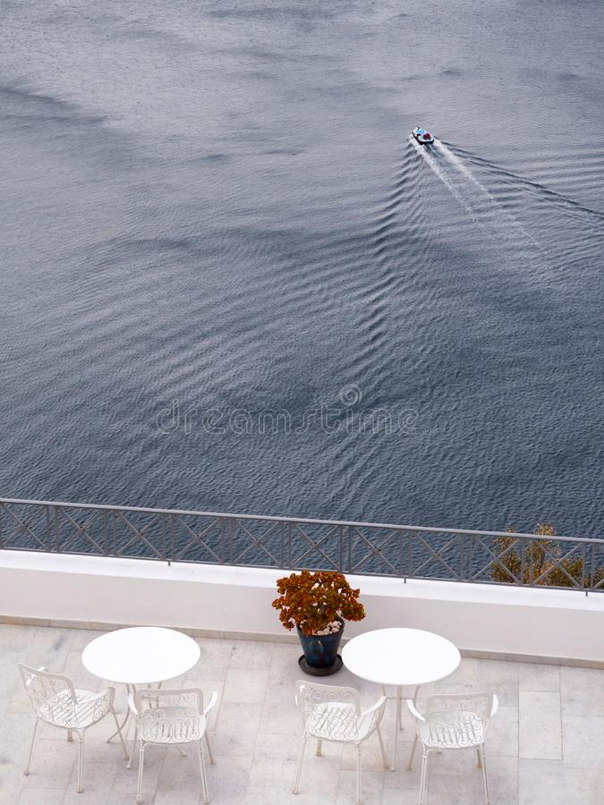 Balcony with tables and beautiful sea view stock images