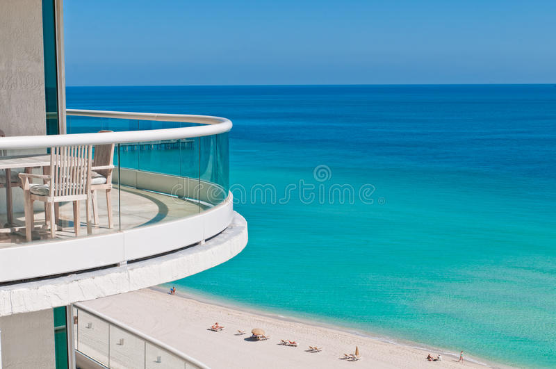 Balcony to the ocean. Balcony over the beach in Miami, relaxing tourists in the beach stock images