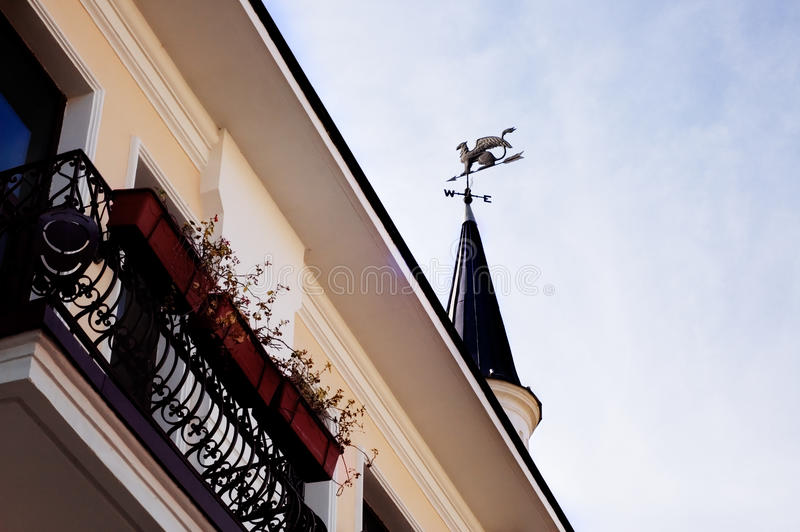 Balcony and tower with weather vane with griffin. In Sukhumi, Abkhazia stock image