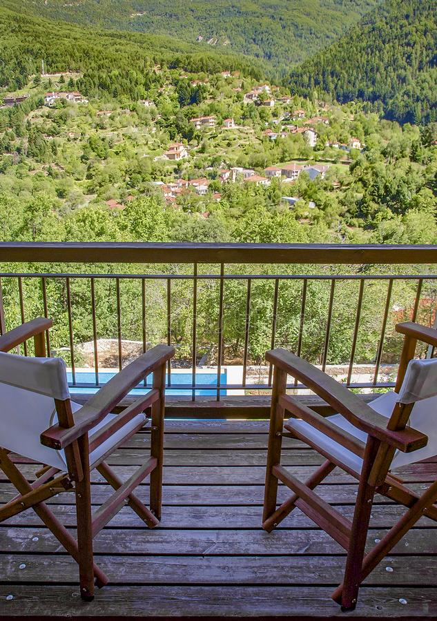 Balcony with view to green nature. Zarouhla village in Ahaia, Greece. stock photo