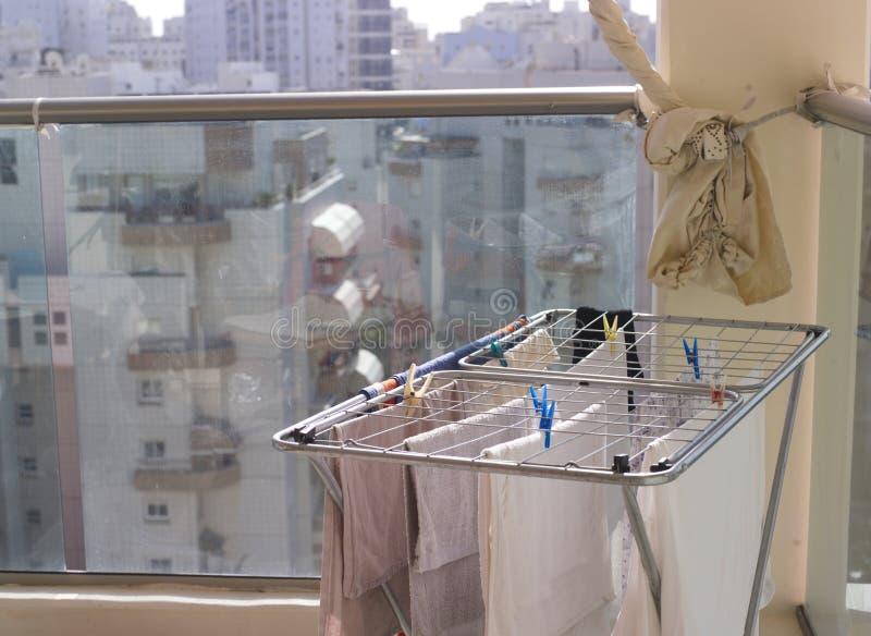 Balcony with washed laundry stock image
