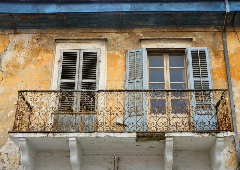 Balcony and windows with shutters of old house in Limassol,Cyprus stock images