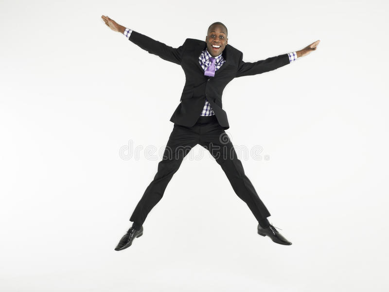 Bald Businessman Jumping In Star Shape stock photography