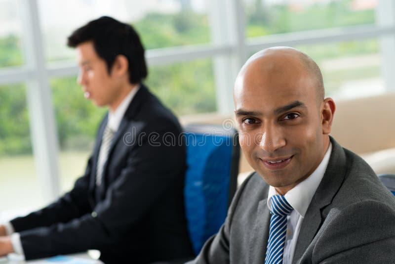 Bald businessman stock image