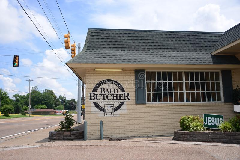 The Bald Butcher, Covington, Tennessee. The Bald Butcher in Covington, Tennessee serves American soul food including chicken, steak, frog legs, meatloaf, mashed royalty free stock photo