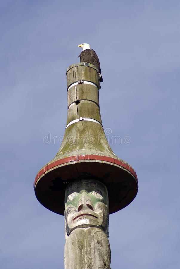 Bald eagle and totem pole Vancouver stock photography