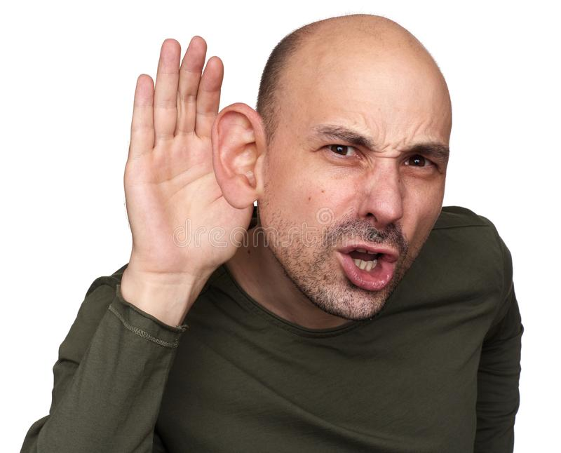 Bald guy do not hear what you say. Bizarre man staring at camera with confused look. Bald guy do not hear what you say royalty free stock photos