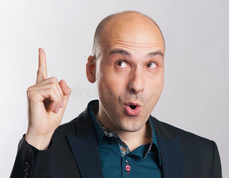 Bald guy having a good idea royalty free stock photos
