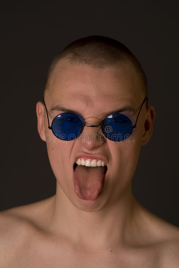 Download The bald guy shows tongue stock photo. Image of adult - 4145796
