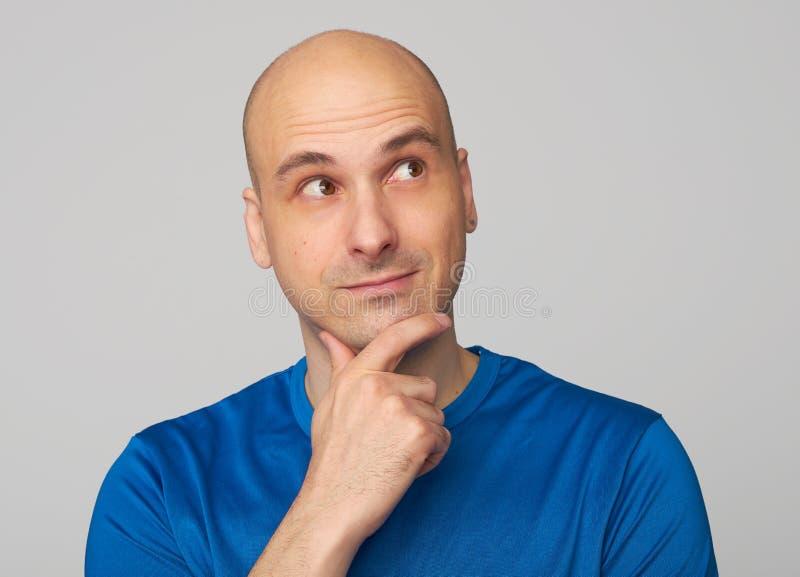 Bald guy wondering royalty free stock photo