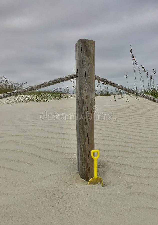 Bald Head Island North Carolina. A post in the sand with a trowel on the Bald Head Island, North Carolina royalty free stock image