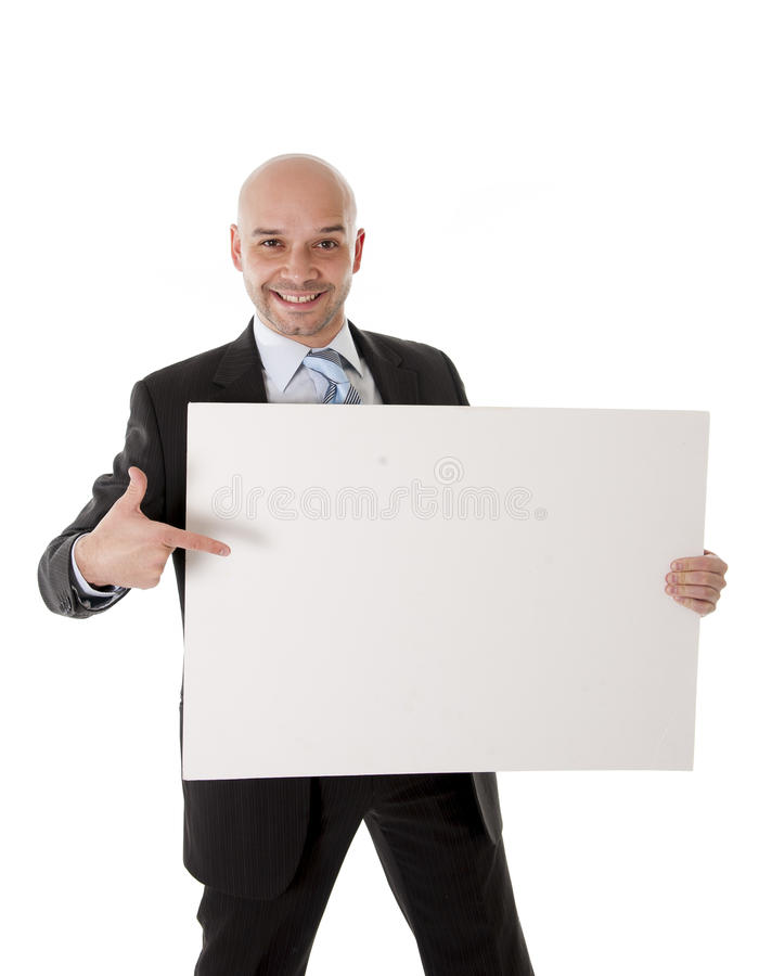 Bald latin business man holding blank sign for advertisement royalty free stock photos