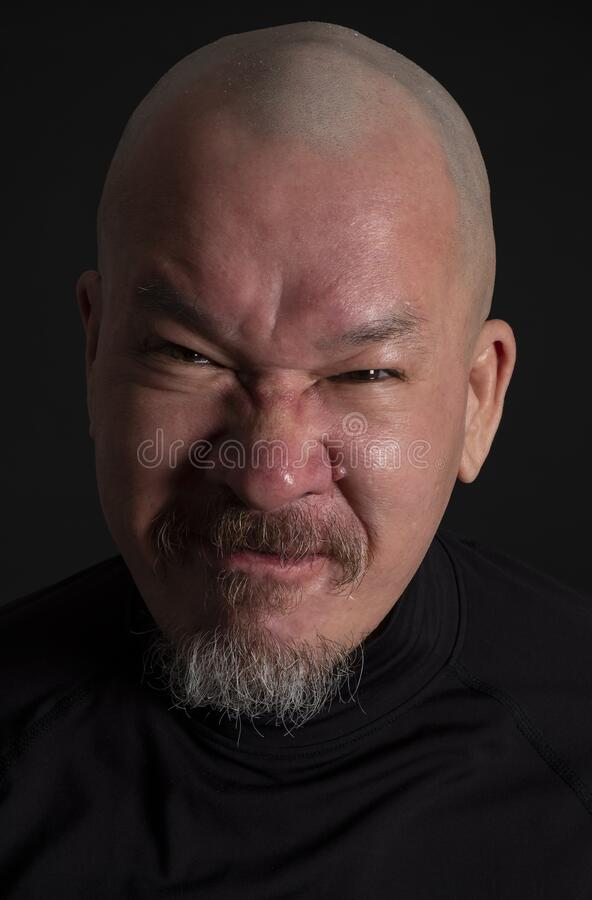 A Bald Man with Beard and an Angry Expression on His Face #3 stock photo
