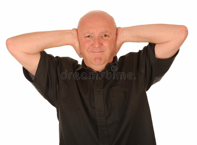 Bald man covering ears. Portrait of bald man in black shirt covering ears, white background stock images