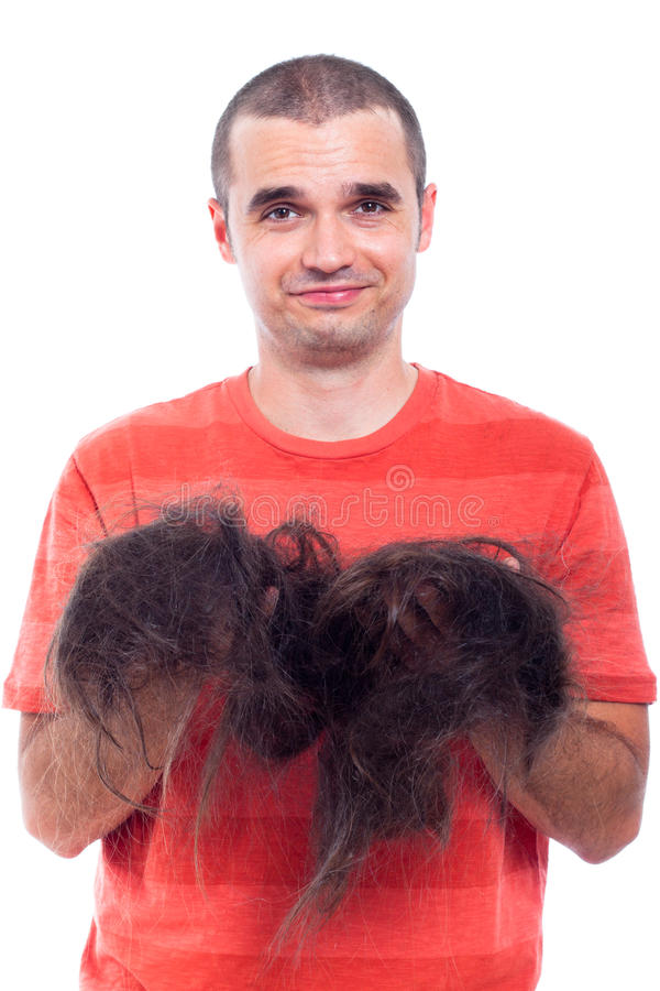 Download Bald Man Holding His Long Shaved Hair Stock Image - Image: 26082473