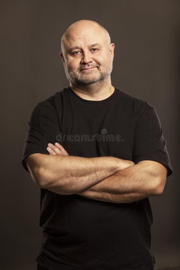 Bald man laughs close up stock image