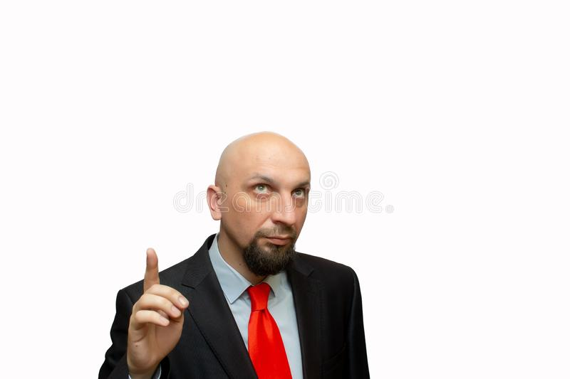Bald man looks up and points his finger up, place for text, shaved head stock photography